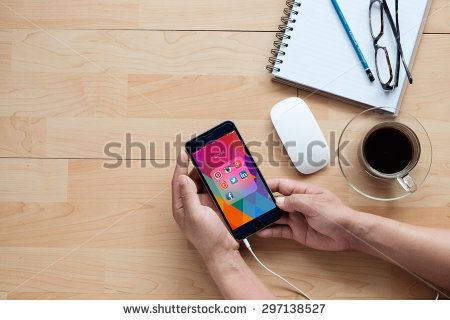 CHIANG MAI, THAILAND - JULY 14, 2015: A man hand holding Group of Popular Social networks icons showing on Apple iPhone 6 plus screen device.