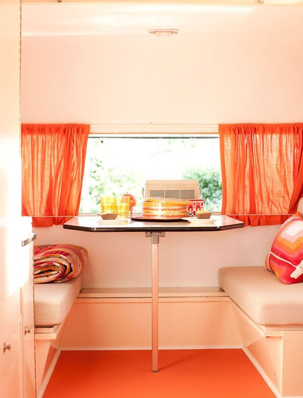 retro caravan interior. love the orange. and like the guide wire or rod that has the curtains tuck into along the bottom.