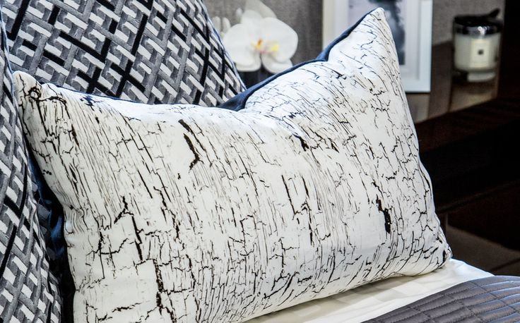 Crisp and contemporary, we used monochrome cushions in our design of these magnificent Sunseeker yachts, these trendy print fabrics by Romo luxurious to the touch.
