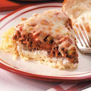 "Spaghetti Pie Recipe -A classic Italian combination is remade into a creamy, family-pleasing casserole in this quick and easy dish. ""This recipe was given to me several years ago,"" notes Ellen Thompson from Springfield, Ohio. ""My family never grows tired of it."""