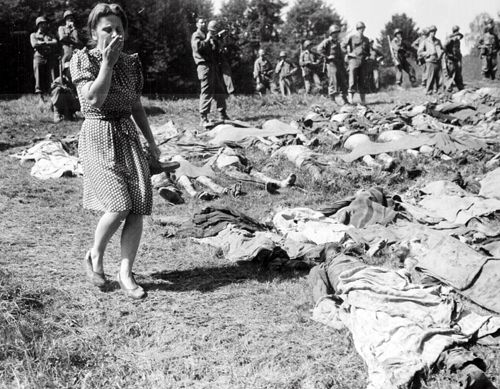 A German girl is overcome as she is forced to walk through and around the exhumed bodies of some 800 slave workers that the SS guards near Namering, Germany murdered. The US Army who liberated the camp laid them out so that the townspeople, who feverishly denied knowledge of the camp, could view the work of their Nazi leaders.