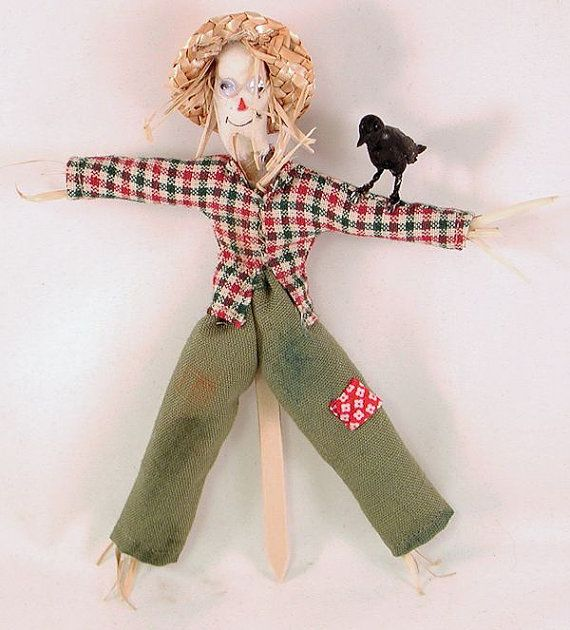 Fall or Halloween scarecrow character doll in plaid shirt and straw hat, with raven on his arm. 1 to 12 dollhouse scale. Handmade in USA.