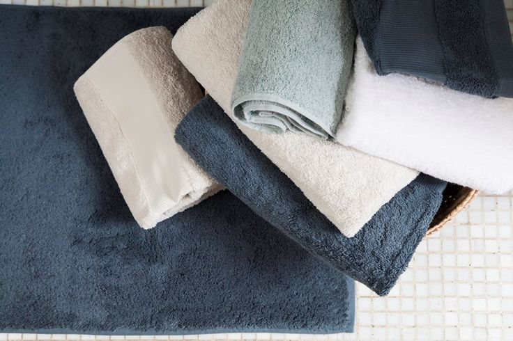Terry bath towels and mats. Different sizes and several colors. 100% cotton.