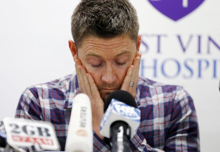 Australian cricket captain Michael Clarke pauses before delivering a statement, on behalf of the family of deceased teammate Phillip Hughes, at St Vincent's Hospital in Sydney, November 27, 2014. Australian cricketer Hughes died in hospital, two days after the international batsman was struck on the head by a ball during a domestic match.