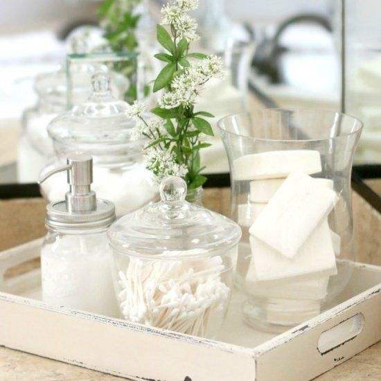 Easily add French farmhouse charm to your bathrooms by placing jars of necessities on a fun tray.