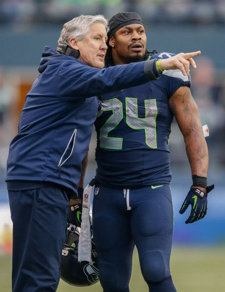 Marshawn Lynch Head coach Pete Carroll of the Seattle Seahawks talks with running back Marshawn Lynch #24 during the game against the St. Lo...