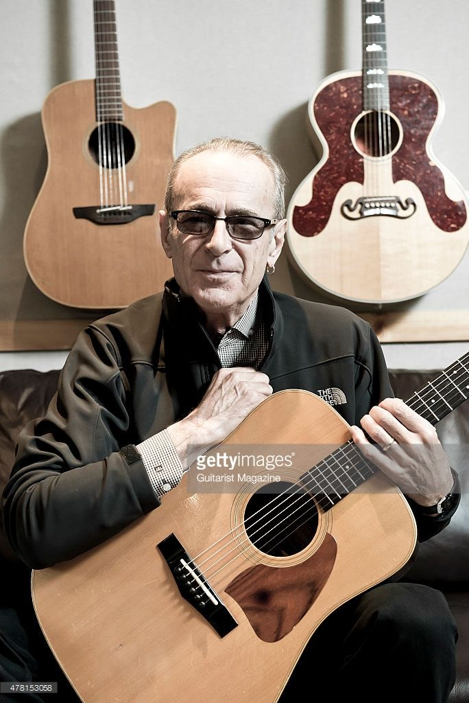 Portrait of English musician Francis Rossi, vocalist and guitarist with rock group Status Quo, photographed at his home in Purley, London, on August 26, 2014.