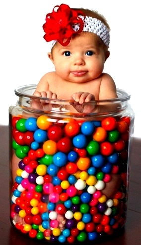 Baby girl in a jar with gum balls. I would love to do this someday when i have children of my own :)