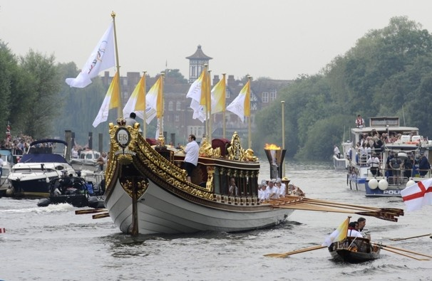 London 2012 Olympics: The royal barge carries the Olympic flame
