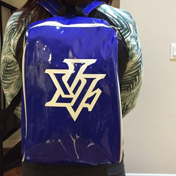 Las Vegas Logo Patent Blue and White  Backpack Las Vegas Logo Patent Backpack color: Blue and White Height 15 inches Length 10 inches Width 5 inches. With this backpack your ready for the gym, school, or out on the town  accent your wardrobe and be city chic  HBCali Bags Backpacks
