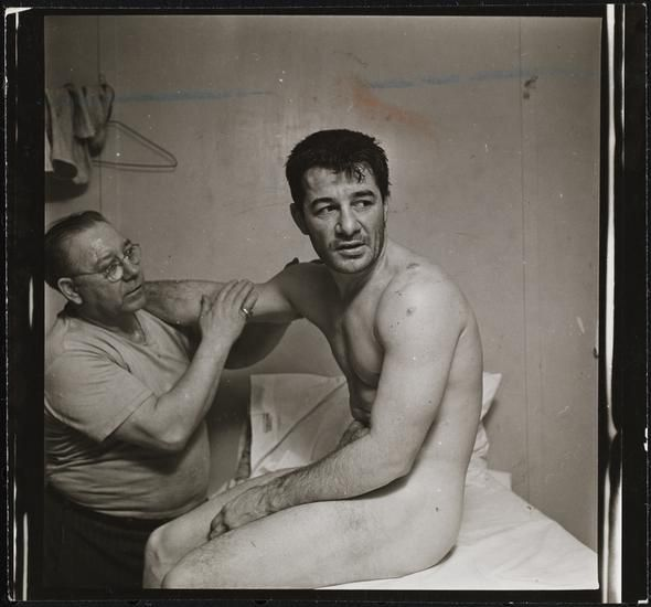 Museum of the City of New York - Rocky Graziano, He's a Good Boy Now [Man massaging Rocky Graziano's arm.]
