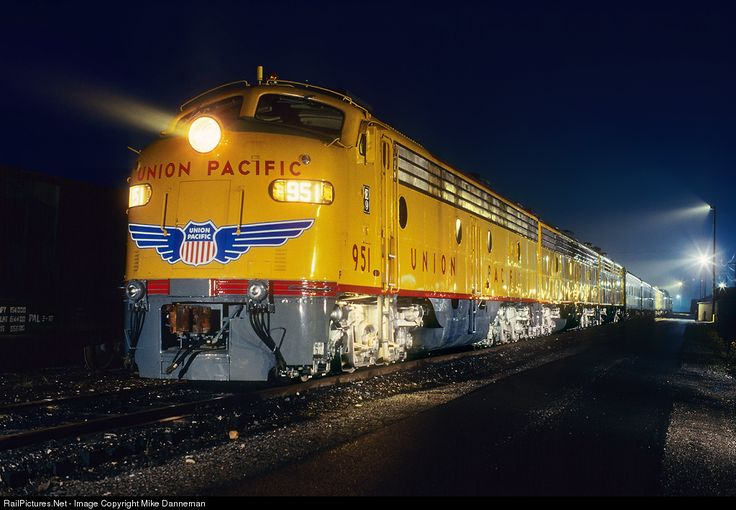 Rainy Paducah nights: On the eve before returning to home rails after an extensive rebuild at the Paducah Shops, Union Pacific's A-B-A set of E9s sit in the fog and rain with a passenger train in Paducah, Kentucky, on April 25, 1993.