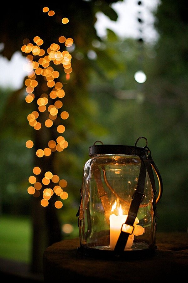 Vintage lanterns with real candles inside as outdoor wedding lights.