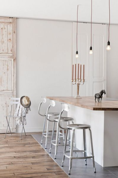 simple island, industrial chairs and hanging bulbs