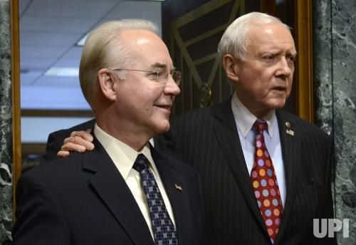Georgia Rep. Tom Price, (L), nominated to be Health and Human Services secretary, arrives with Utah Sen. Orrin Hatch, for Price's Senate…
