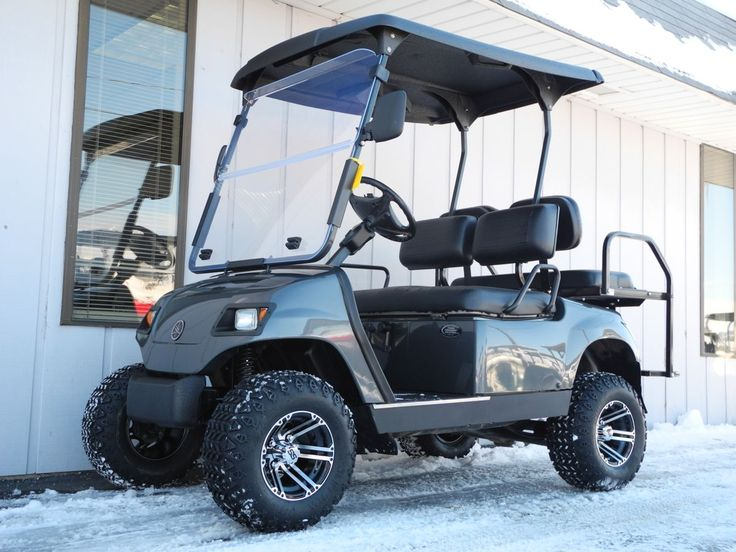 This 2006 Yamaha G22 street-ready custom gas golf car has a freshly-painted Metallic Charcoal Gray body, new black seat covers, new rear flip seat, 3-inch lift kit, black Line-X hard top, and new 20-inch Desert Fox all-terrain tires on 10-inch aluminum wheels! Plus it's street-ready with premium lights, folding windshield, horn, dual side-mounted rear view mirrors, and license plate bracket. All for just $4690.   #Yamaha #G22 #streetready #customgolfcar