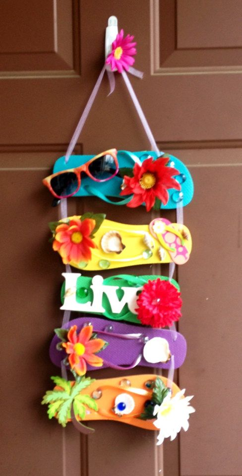 Here is a fun, sassy, colorful addition to any patio, front door, office, or classroom. I made this wreath out of colorful small flip flops. Sewn together with purple sheer ribbon and topped with a small purple Gerber daisy. Its sure to delight anyone who revels in spring and summer weather. Each flip flop is adorned with a silk flower, sparkly rocks, and a sea shell. Today is a gift. Thats why its called the present. This wreath reminds you to live in the present.    *The 1st flip flop is…