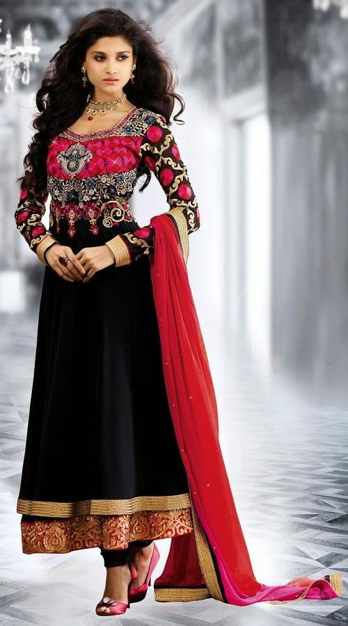 Snazzy black georgette long anarkali suit which is decked with stone, zari, resham embroidery work on the yoke and sleeves part, golden lace work on the lower part and gold zardosi work on the border. Matching bottom and contrast dupatta attached with this attire.This Salwar Kameez can be stitched in the maximum bust size of 44 inches.