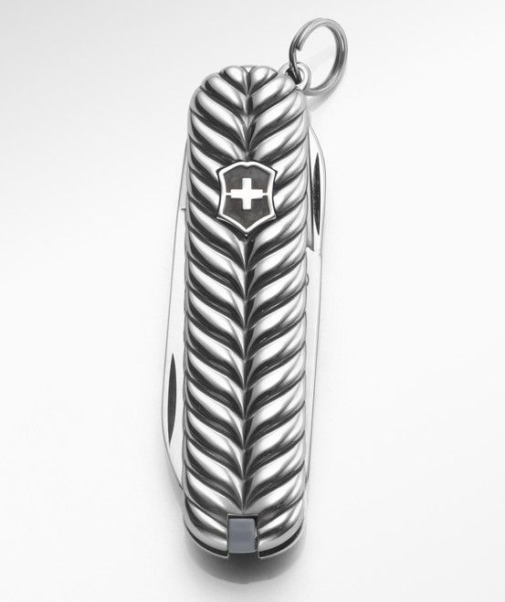 David Yurman has partnered with Victorinox to create a unique Swiss Army® Knife collection. Each piece, intricately detailed in sterling silver, is part of a broader collection in the David Yurman men's line, such as this design in the Chevron motif.