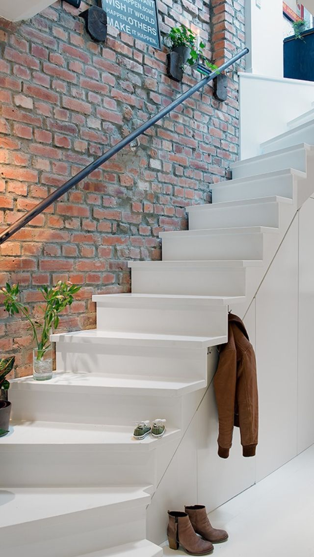 clean stair design to exposed brick - nice contrast