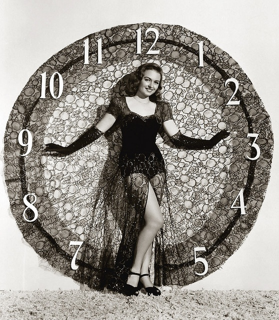 An alluring clock and matching ensemble of lace was all actress Donna Reed needed to ring in the New Year. :)