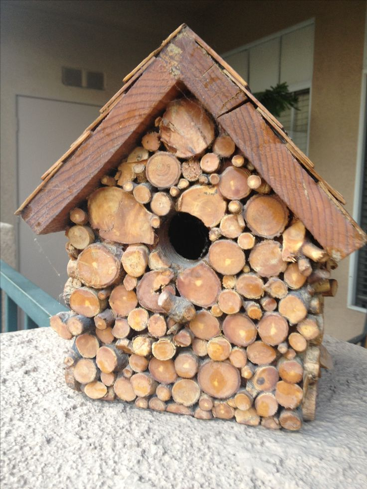 """Wooden """"dowels"""" or really branches sliced to cover this birdhouse in log shingles"""