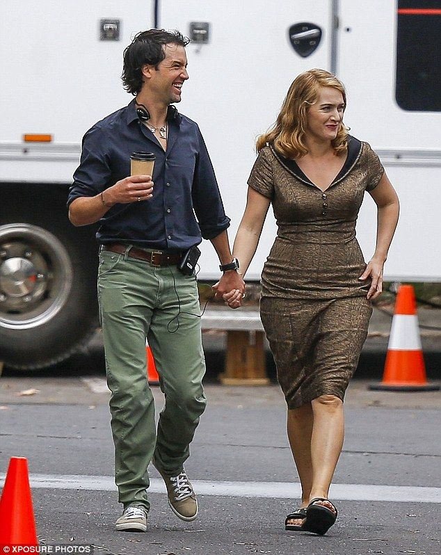 I love Kate Winslet's 1950's style dress that she is pictured in here on the set of new movie, which is set in 1950's Australia.  (Not the off duty sandals though).