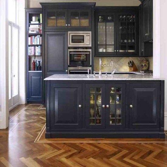 Open-plan kitchen with parquet floor, dark cabinetry and granite worktop