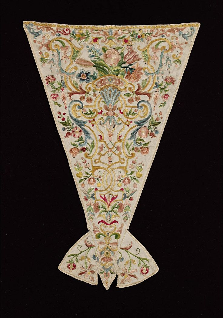 Stomacher, Italy, early 18th century. White silk embroidered with polychrome silks in Baroque floral motif.