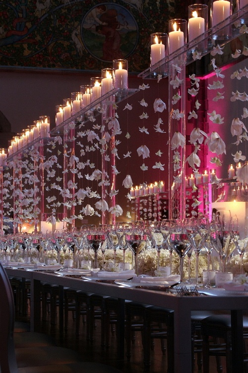 elegant and grand table setting with candles up high weddings and special event probably combine flower and candles up high