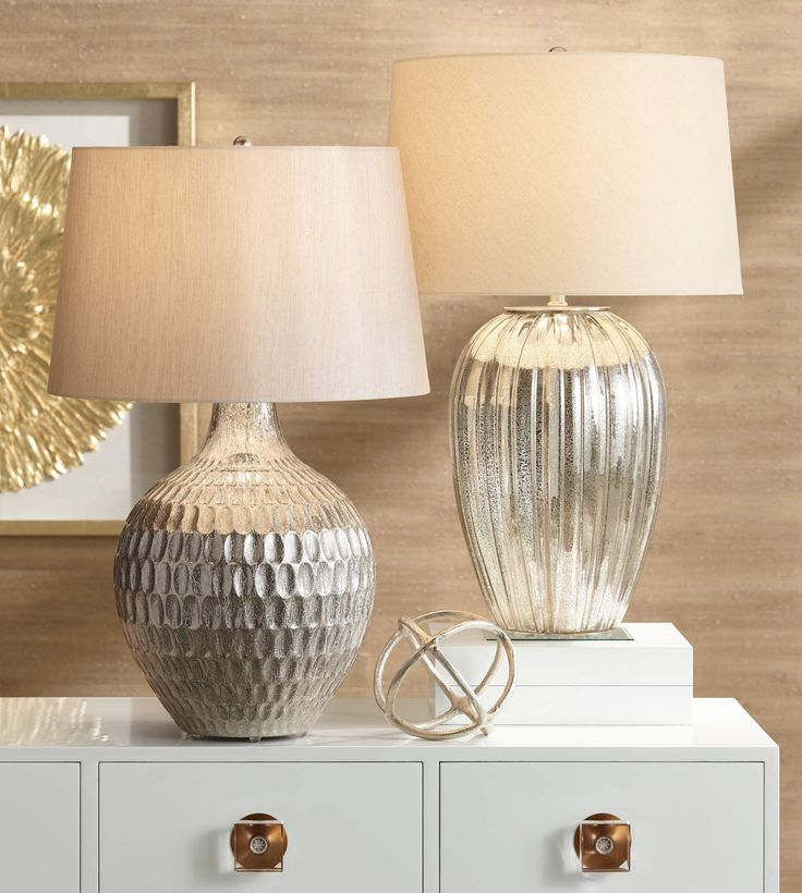 A dazzling mercury finish helps this stunning transitional table lamp to bring modern sensibility into any room