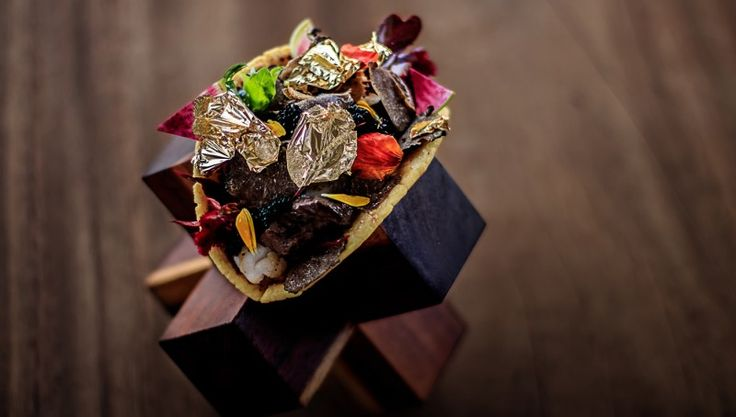 The world's most expensive taco is priced at $25,000 for two is filled with Kobe beef, lobster, truffles and rare Alba caviar that is harvested from Iranian albino sturgeon, 60 to 100 years old.  It also has gold flakes and a salsa made with the excreted coffee berries of the civet cat.  One part of me says WOW but the other says when people are starving, this is nasty porno.