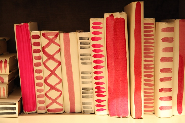Love these painted book covers by Hable at Hickory Chair.