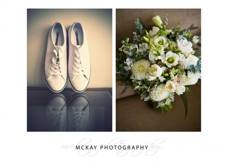 Bride's flowers and white Chuck Taylor wedding shoes  #chucktaylor #converse #wedding