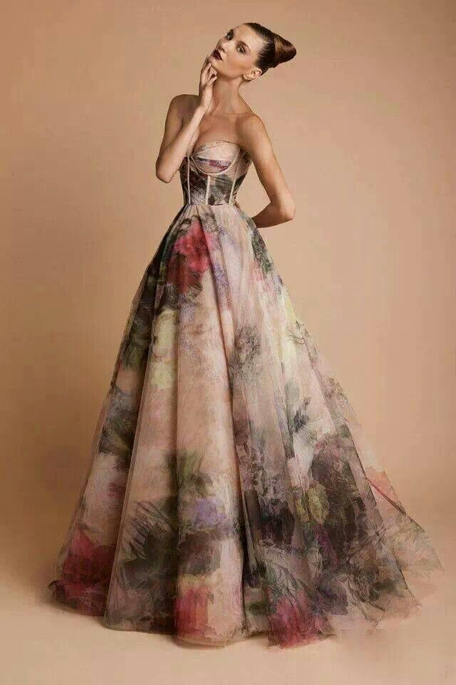 Gorgeous strapless Rani Zakhem gown in a watercolor floral with gauzy ball gown skirt and bustier bodice.