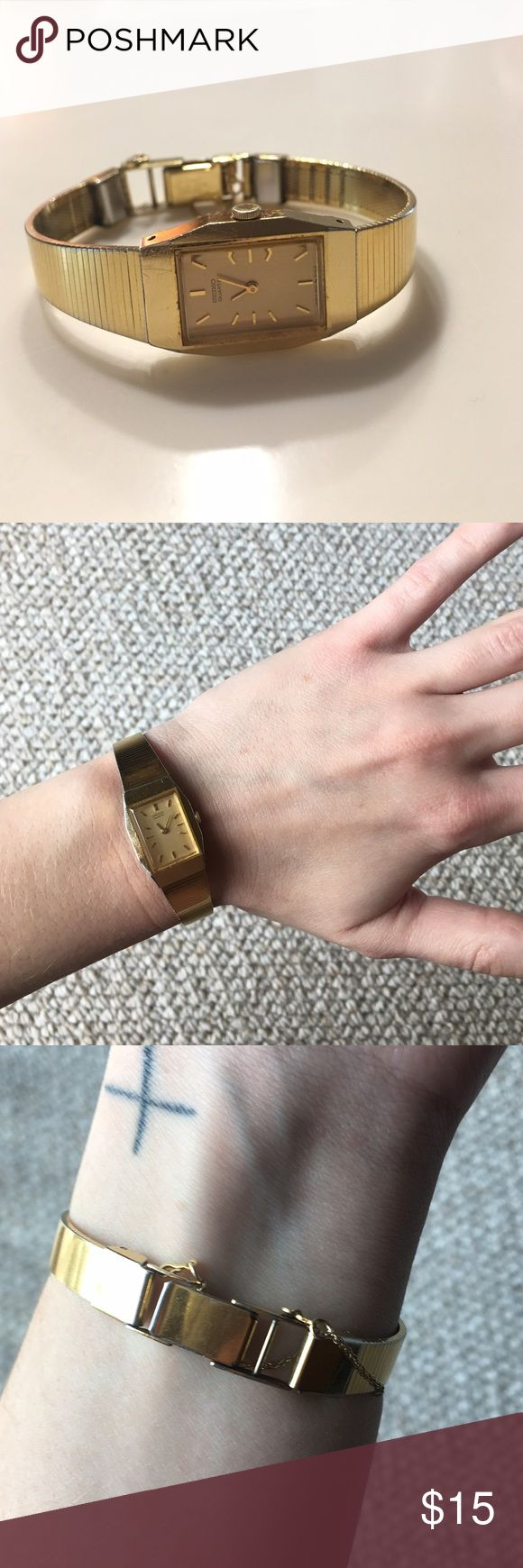 Seiko Gold Watch It's a small fit, but a pretty gold watch! Held together by a clasp and chain in the back. ⏰✨ (needs a new battery) Seiko Accessories Watches