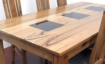 This table is sure to impress. Solid Jarrah with granite inlays and leather chairs- this is one sexy table