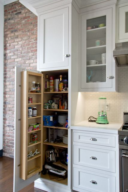 add a shallow shelf for condiments & spices to the inside of the pantry cabinet door for extra storage, all your shelves would have to be cut back :/
