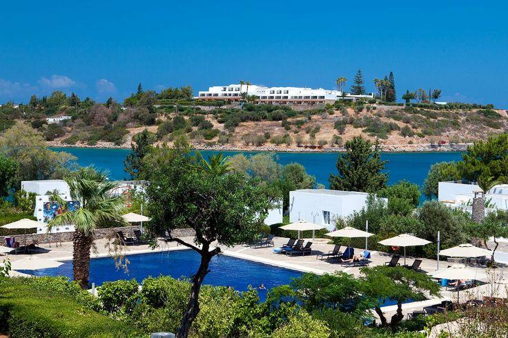 Minos Beach Art Hotel Nestled along the waterfront... | Luxury Accommodations