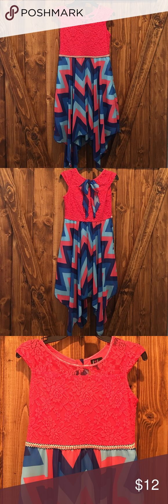 Lace & Chevron Dress This dress is gently used, in excellent condition! Beautiful shade of pink lace on top. Pink and 2 shades of blue chevron pattern on bottom. Slip underneath. Back has cute detail! Dresses