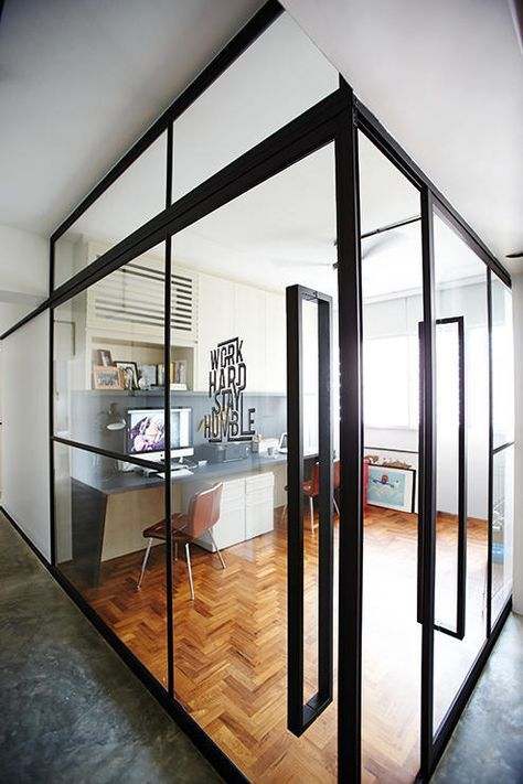 It brightens up the common area when you replace the walls of a study with glass. Use black frames for a sharp, urban aesthetic.    (Interior design by Produce)