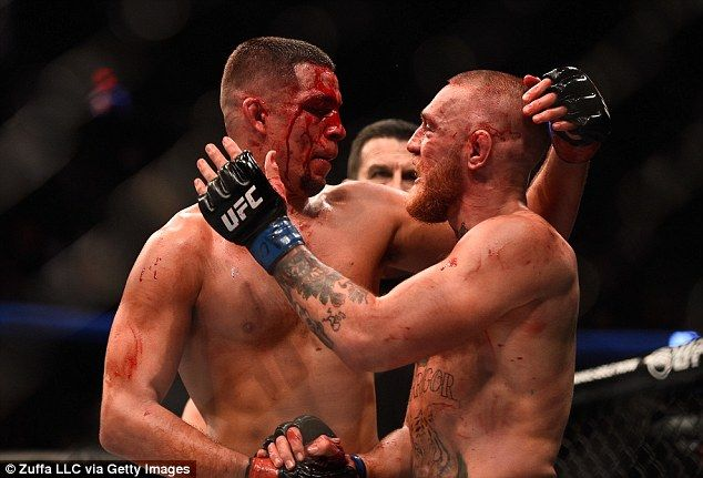 A blood-covered Diaz and McGregor came together after their gruelling contest...