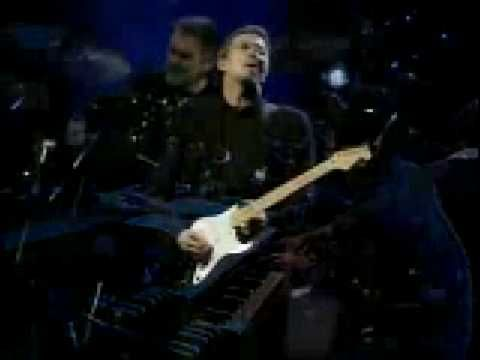 "Amazing Eric Clapton guitar solo ~ ""2 + min. solo @ the end, expect no less from Clapton.""  ~._*G*_.~"