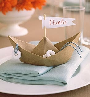 Cute paper boat party favor with mints as life buoy. you could even tie some gummy fish to string, or put some gummy fish in one corner and make a small string net...