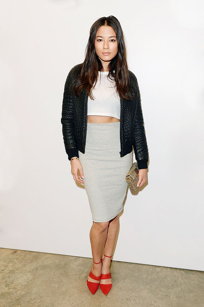 Jessica Gomes gets sporty with a ribbed white crop top, tube skirt and bomber jacket, all by Topshop // #Trend #Style