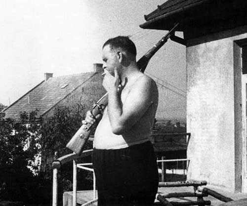 "Camp Commandant Amon Goeth, infamous from the movie ""Schindler's List"", standing on his balcony preparing to shoot prisoners, 1943"