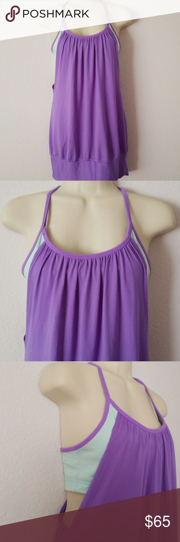 LULULEMON PURPLE TANKINI Loose Fitting Tankini in purple with contrasting aqua padding. In EUC.  Great for tennis or a jog in the park.  Size  6. Padding not included.    1 lululemon athletica Tops Tank Tops