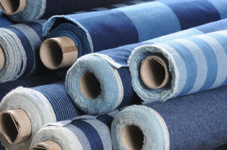 rolls of indigo denim fabric
