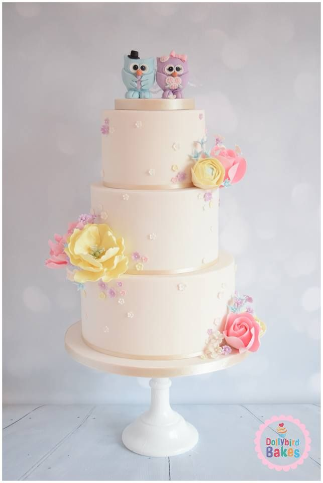 A pretty floral themed cake, featuring sugar peonies and whimsical roses,ranunculus and hand crafted owl toppers