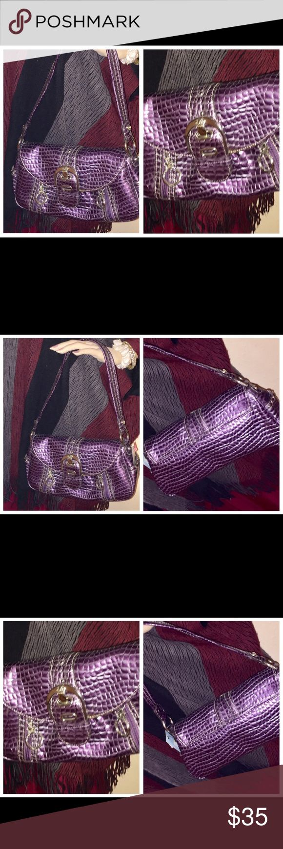 NWT KATHY VAN ZEELAND PURPLE REPTILE PRINT PURSE NWT KATHY VAN ZEELAND PURPLE REPTILE PRINT PURSE BAG. MEASURES 12 inches across and is 7 inches in length. With the strap it is 15 inches long. Kathy Van Zeeland Bags Shoulder Bags